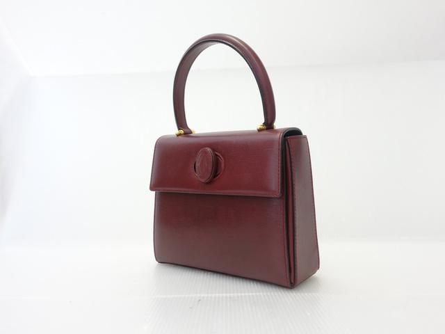 カルティエ マストライン ケリー型のハンドバッグ